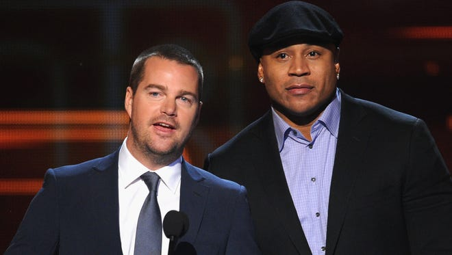 Actors Chris O'Donnell (L) and LL Cool J speak onstage at The 40th Annual People's Choice Awards at Nokia Theatre L.A. Live on Jan. 8, 2014, in Los Angeles. The two will co-host the Academy of Country Music's annual television special.