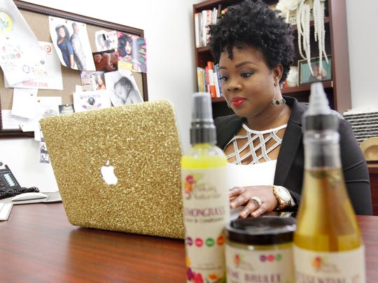 Rochelle Graham works in her office Wednesday at Black Onyx World in east Fort Myers. Graham created her own line of beauty products called Alikay Naturals, some of which are now available in some Sally Beauty Supply and Target stores.