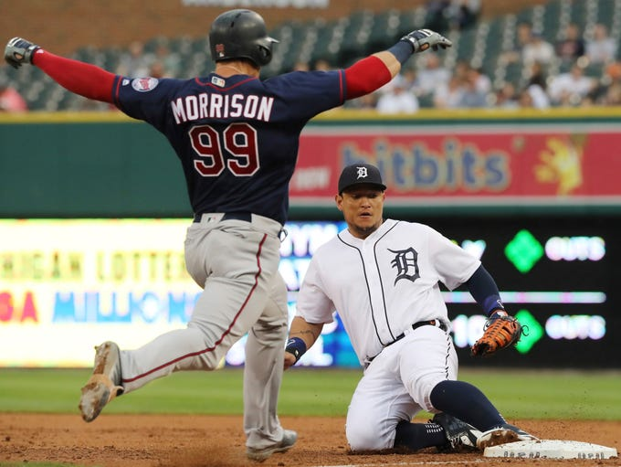 Detroit Tigers first baseman Miguel Cabrera, right,