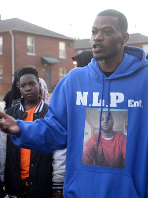 Quewlyn Mays speaks to a group of marchers at the conclusion of an anti-crime march Friday evening at Allenton Heights Housing Complex. Mays lost his cousin in Illinois.