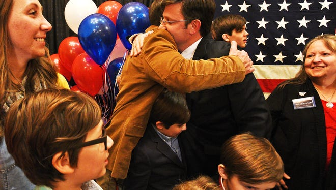 State Rep. Mike Johnson hugs his supporters after winning the 4th Congressional District race.
