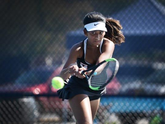 Riya Ravi of Northern Highlands makes a backhand return