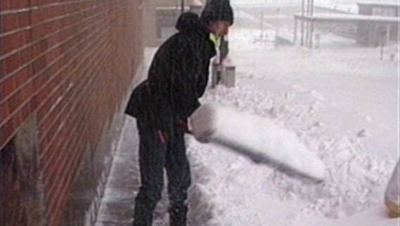 A photo from the National Weather Services shows a man shoveling snow during the infamous Halloween Blizzard in 1991.