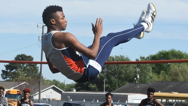 Beau Chene's Jhaleb Citizen clears the high jump bar at 6 feet, 2 inches Wednesday. The jump enabled Citizen to win the event by two inches over Caleb Allen and Kammryn Jones, both of Northwest, who went 6-0.