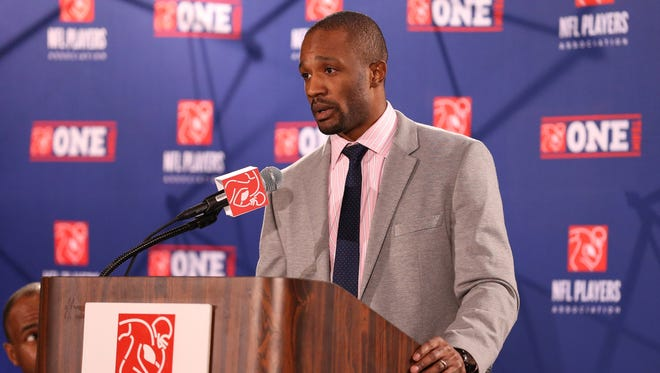 NFLPA president Domonique Foxworth addresses reporters in 2013 before Super Bowl XLVII in New Orleans.