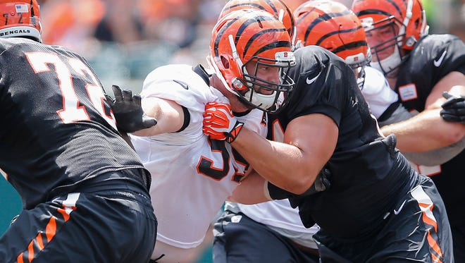 Bengals defensive end Margus Hunt tries to break through the offensive line during training camp on Saturday.