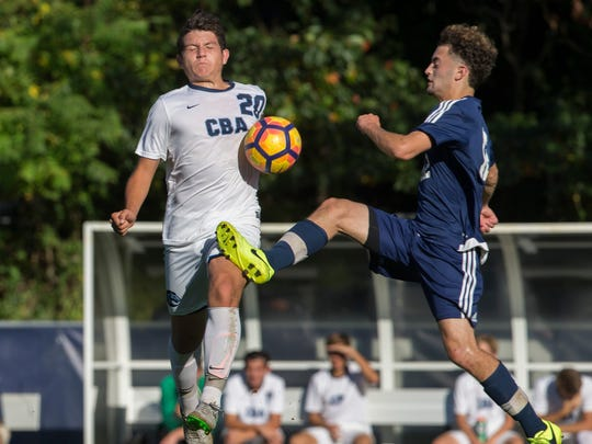 CBA's Lluke Pascarella and Howell's Adam Jiries battle for ball near midfield during Christian Brothers vs Howell Boys Soccer in Middletown, NJ on October 10, 2017.
