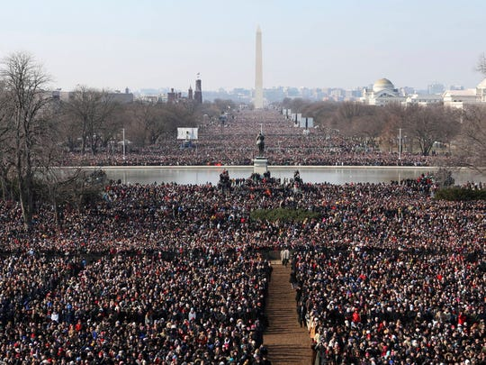 Crowds gather to watch the Obama's inauguration on