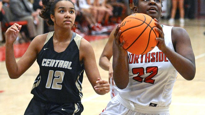 Northside's Haitiana Releford, right, drives to the basket ahead of Little Rock Central's Lillian Jackson on Tuesday, Jan. 14, 2020, at Northside. Northside won the game 56-26.