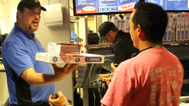 Domino's Pizza, 100 S. White Sands Blvd., hosted a fundraiser on Thursday for a 5-year-old Alamogordo girl with cancer. The business donated Thursday's profits to help the little girls' family pay for her medical bills. Domino's made about 667 pizzas Thursday. A Domino's employee hands a customer his pizza Thursday.
