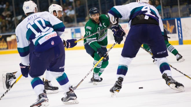 The Everblades' Brant Harris (23) eyes the puck during the third period of Game 2 of the Kelly Cup Playoffs, South Division semifinals at Germain Arena Friday, April 14, 2017 in Estero, Fla. Orlando would win 3-2 to take a 2-0 series lead.