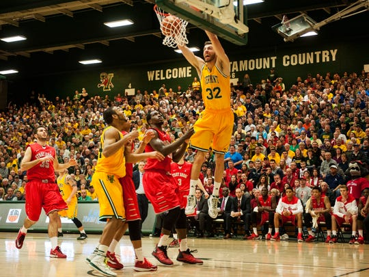 Catamounts forward Ethan O'Day (32) dunks the ball during the America East semifinals against Stony Brook earlier this month.