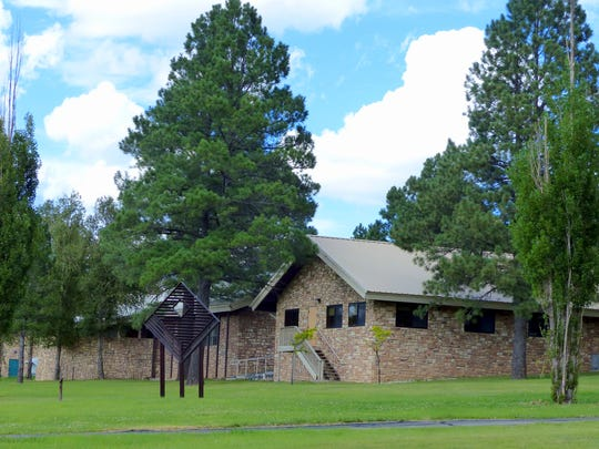 Ruidoso Village Hall backs up to The Links walking path.