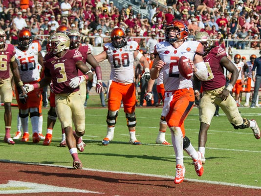Syracuse quarterback Eric Dungey walks into the end zone unchallenged in the second half of an NCAA college football game against Florida State in Tallahassee, Fla., Saturday, Nov. 4, 2017. Florida State defeated Syracuse 27-24. (AP Photo/Mark Wallheiser)