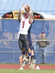 Owego's Zach Miner tries to intercept a pass intended for Susquehanna Valley's Billy Sheridan.