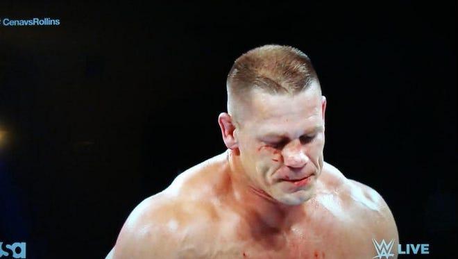 Screenshot of John Cena beats Seth Rollins despite suffering a broken nose mid-match