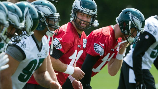 Chase Daniel, center, said he's willing to help rookie Carson Wentz, right, prepare to be the Eagles' starting quarterback.