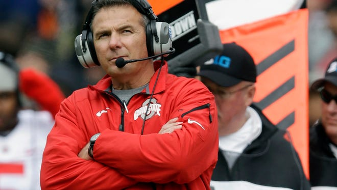 FILE - In this Nov. 2, 2013, file photo, Ohio State head coach Urban Meyer watches from the sideline during the second half of an NCAA college football game against Purdue in West Lafayette, Ind. Ohio State tied a previous school record with a quintet of players selected in the first round Thursday night, April 28, 2016, in Chicago. (AP Photo/Michael Conroy, File) ORG XMIT: NY901