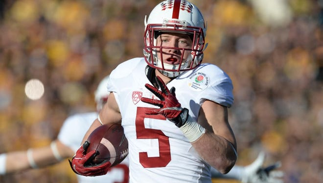 Jan 1, 2016; Pasadena, CA, USA; Stanford Cardinal running back Christian McCaffrey (5) runs for a touchdown against the Iowa Hawkeyes during the first quarter in the 2016 Rose Bowl at Rose Bowl. Mandatory Credit: Richard Mackson-USA TODAY Sports ORG XMIT: USATSI-233952 ORIG FILE ID:  20160101_lbm_am8_029.JPG