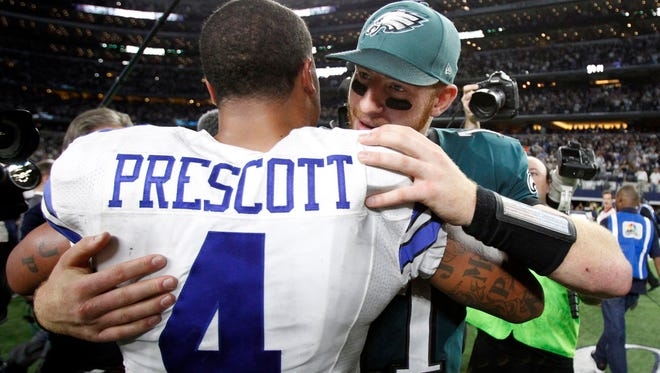 Eagles quarterback Carson Wentz and Cowboys quarterback Dak Prescott have a brief word after the Cowboys' 29-23 win in overtime on Oct. 30.
