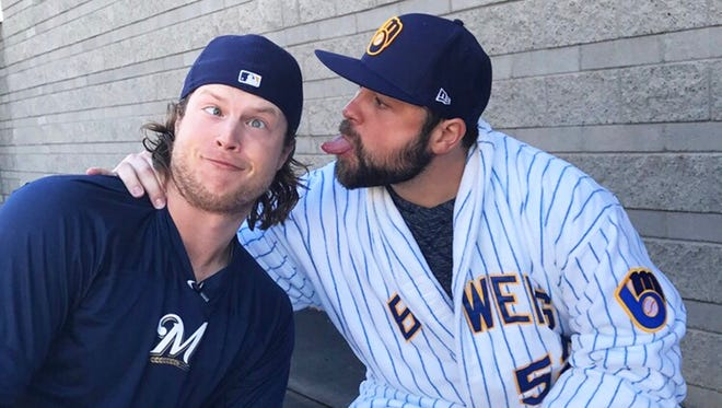 Brewers outfielder Brett Phillips jokes aside teammate pitcher Joba Chamberlain before participating in a spelling bee at Maryvale Baseball Park.