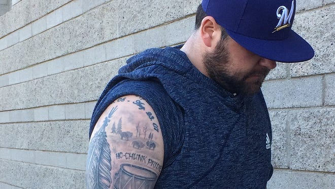 Milwaukee Brewers relief pitcher Joba Chamberlain shows off the tattoos of his Native American heritage on his right arm.