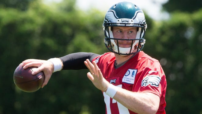 Eagles quarterback Carson Wentz, shown last season, said he's ready for the offseason workouts this season.