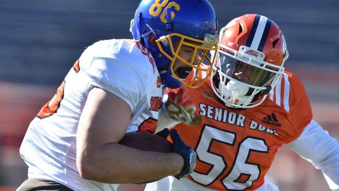 Dallas Goedert of South Dakota St. (86) catches a pass against inside linebacker Dorian O'Daniel of Clemson (56) during Senior Bowl practice at Ladd-Peebles Stadium.
