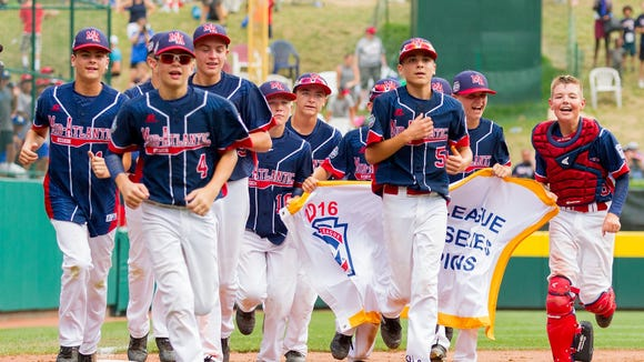Maine-Endwell (N.Y.) celebrates its 2-1 win over Seoul, South Korea, in the 2016 Little League World Series championship game in South Williamsport, Pa.