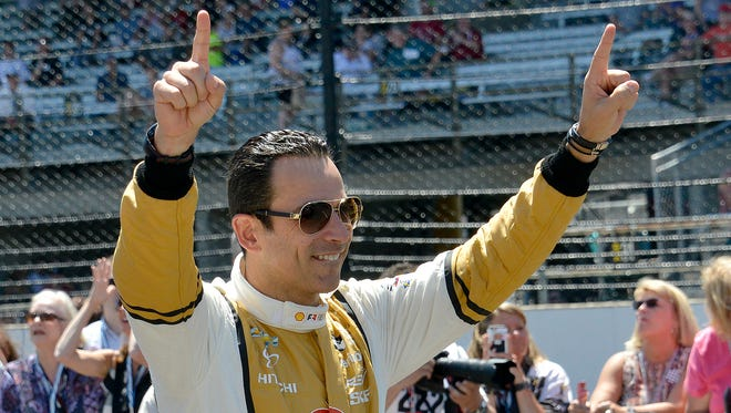 Team Penske IndyCar driver Helio Castroneves happy for his teammate Will Power winning the Indy 500 Pit Stop Challenge during Carb Day practice at the Indianapolis Motor Speedway Friday, May 26, 2017.