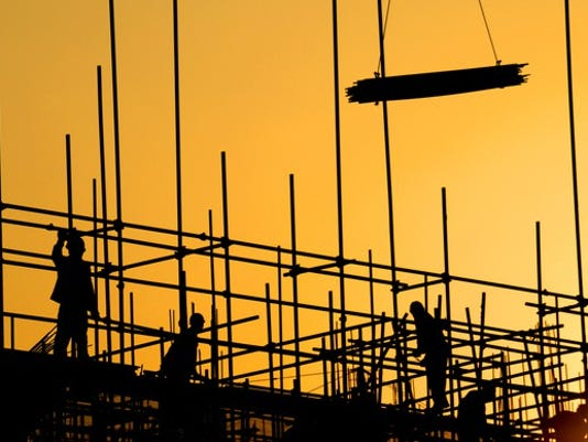 constructions-workers-building-at-sunset-silhouettes_large.jpg
