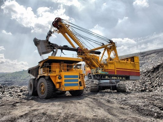 gold-silver-copper-mine-excavator-dump-truck-precious-metal-getty_large.jpg