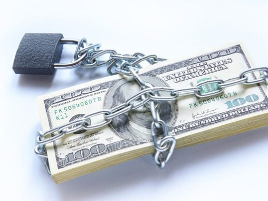 money-under-chain-and-lock-debt-getty_large.jpg