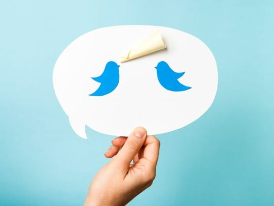 A talk bubble shows two Twitter birds