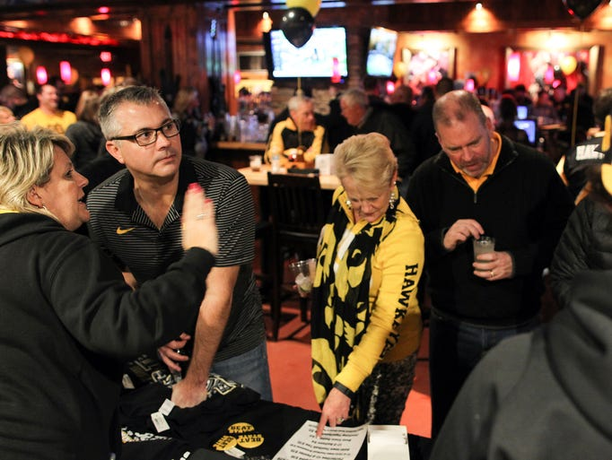 Iowa fans browse merchandise at the Cadillac Ranch
