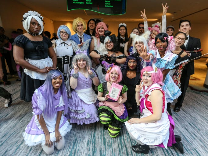 Volunteers dress up in cosplay outfits for the Maid