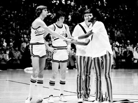 Vanderbilt's Jan van Breda Kolff, left, Terry Compton, Lee Fowler and Bill Ligon meet at center court during introductions prior to the Kentucky game March 2, 1974.