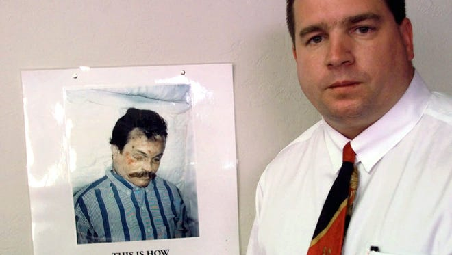 In this 1997 file photo, Kenneth Trentadue, shown in the poster hanging in the office of Oklahoma City lawyer Scott Adams, is pictured in Oklahoma City. Prison officials maintain that Trentadue committed suicide by hanging himself.