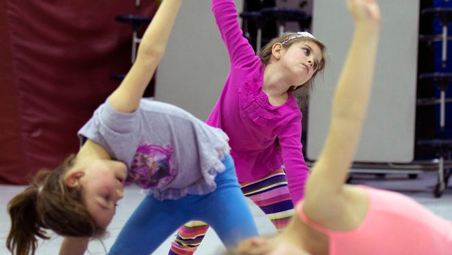 Showell Elementary students work on yoga poses in an after-school class Wednesday, April 29 in Berlin.
