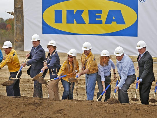 A variety of people from dignitaries, like Fishers Mayor Scott Fadness, second from left, and Congresswoman Susan Brooks, third from left, to IKEA staff throw dirt during the groundbreaking ceremony for IKEA in Fishers, Tuesday, October 18, 2016.