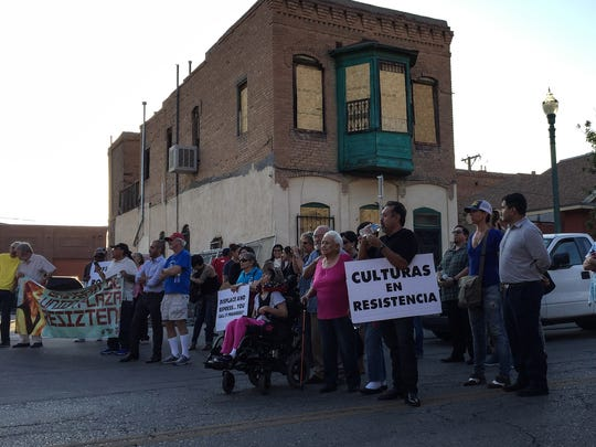 Preservationists and others who oppose the city's plan to build the multipurpose arena in Duranguito protested outside the neighborhood Monday.
