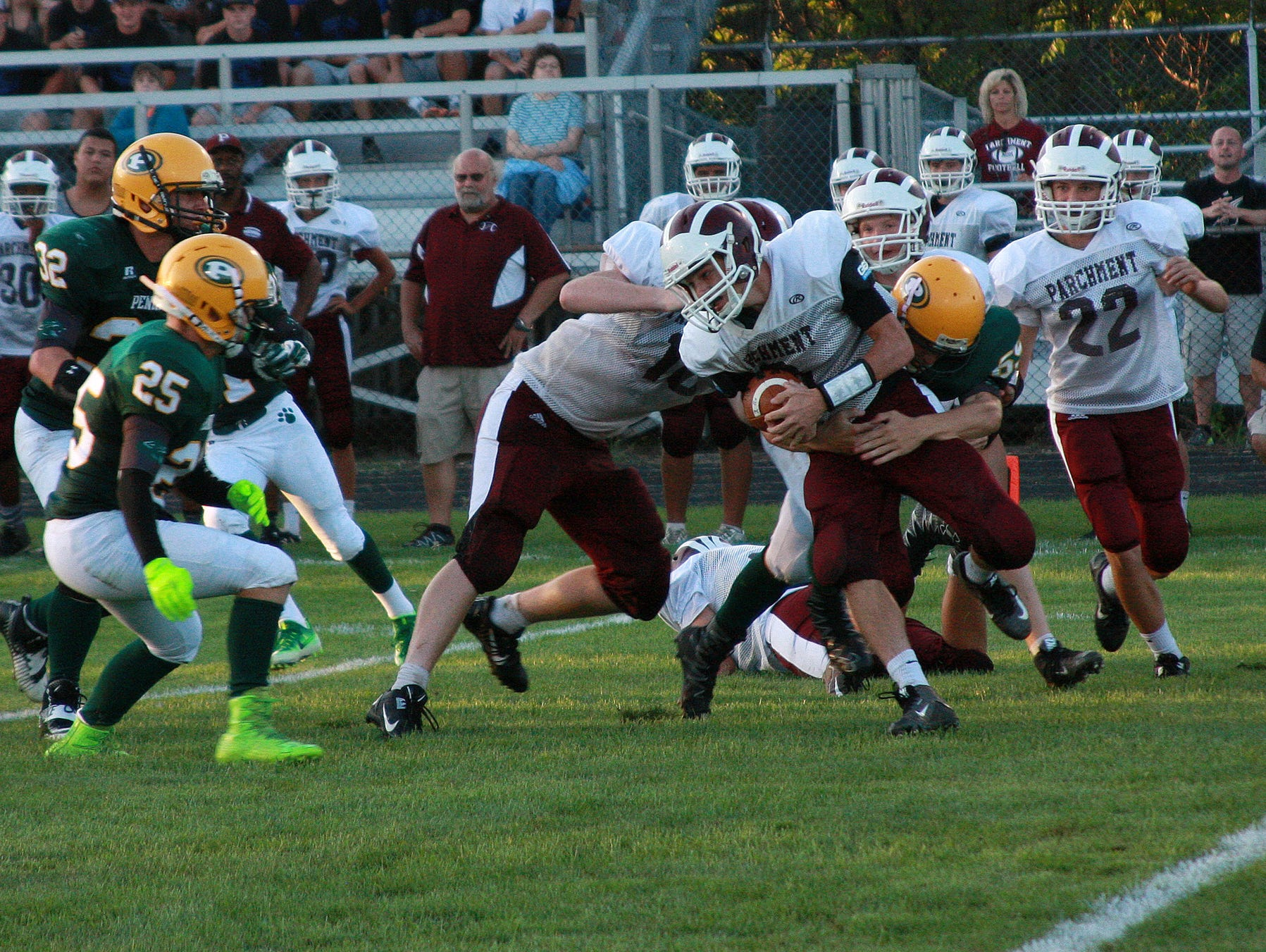 Garrett Stutz of Parchment gets tackled for a loss Thursday night against Pennfield.