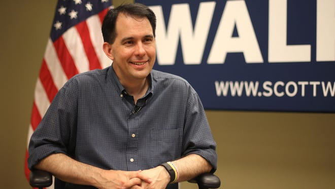 Wisconsin Gov. and Republican presidential candidate Scott Walker spoke with the Des Moines Register from his Iowa headquarters in Urbandale on Friday, July 17, 2015.