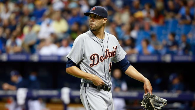 Detroit Tigers starting pitcher David Price (14) walks back to the dugout at the end of the fourth inning against the Tampa Bay Rays at Tropicana Field.