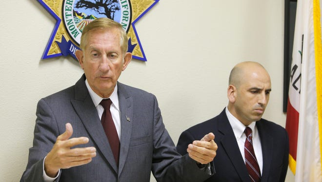 Monterey County District Attorney Dean Flippo and assistant district attorney Rolando Mazariegos speak about the officer-involved shooting of Carlos Mejia.