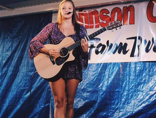 Abbie Callahan has performed with her guitar at countless