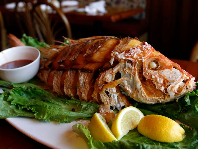 Deep-fried whole red snapper served with a sweet chili