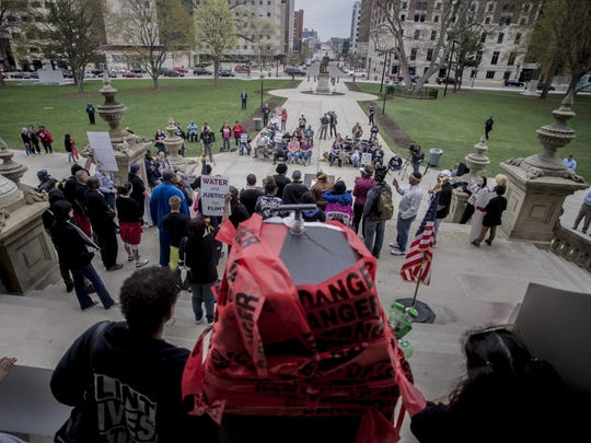 More than 50 Flint residents rally on the five-year anniversary of the Flint water crisis at the Capitol Building on Thursday, April 25, 2019, in Lansing, Mich.