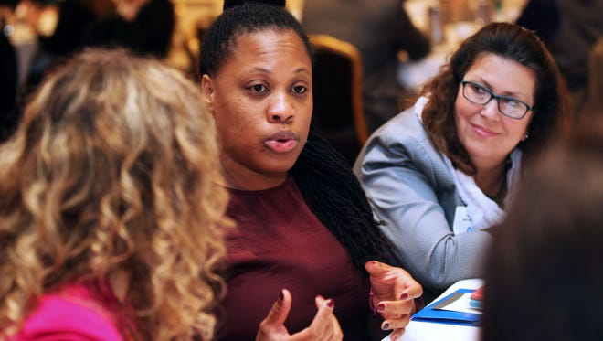 """Lekeasha Mallett (center) speaks at the """"Children and Youth Services"""" table during the Greater Milwaukee Foundation's recent On the Table initiative."""