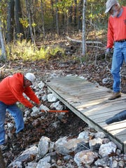 NCAMN's trail patrol cleans up woodland trails along Norfork Lake and in Bull Shoals-White River State Park.